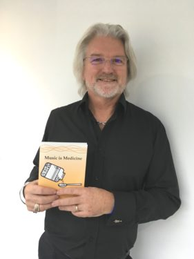 john-with-his-book